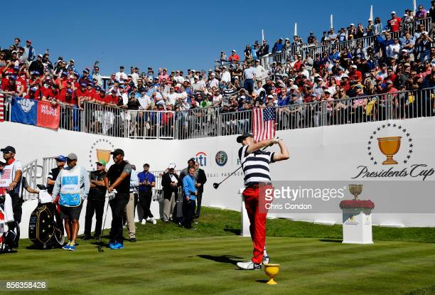 Jordan Spieth of the US Team plays his shot from the first tee during the Sunday singles matches at the Presidents Cup at Liberty National Golf Club...