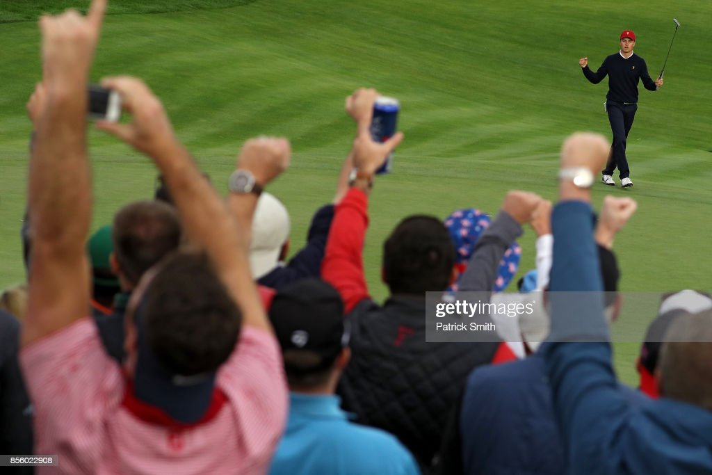Jordan Spieth of the U.S. Team reacts on the 17th green after he and Patrick Reed defeated Louis Oosthuizen of South Africa and the International Team and Jason Day of Australia and the International Team 2&1 during Saturday four-ball matches of the Presidents Cup at Liberty National Golf Club on September 30, 2017 in Jersey City, New Jersey.