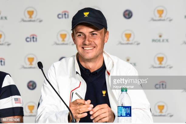 Jordan Spieth of the US Team smiles during a press conference following the team's victory after Sunday Singles matches at the Presidents Cup at...