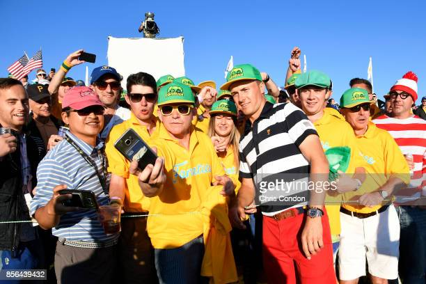 Jordan Spieth of the US Team smiles with the 'Fanatics' during the Sunday singles matches at the Presidents Cup at Liberty National Golf Club on...