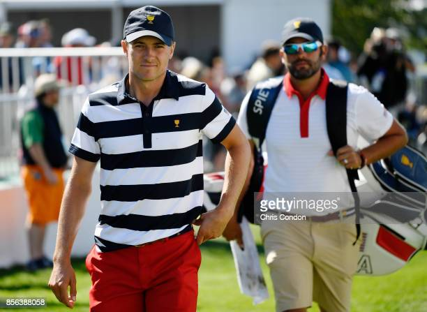 Jordan Spieth of the US Team walks onto the first tee during the Sunday singles matches at the Presidents Cup at Liberty National Golf Club on...