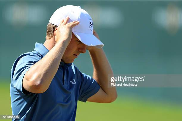 Jordan Spieth of the USA looks dejected as he walks off the 18th green during the resumption of the weather delayed second round of THE PLAYERS...