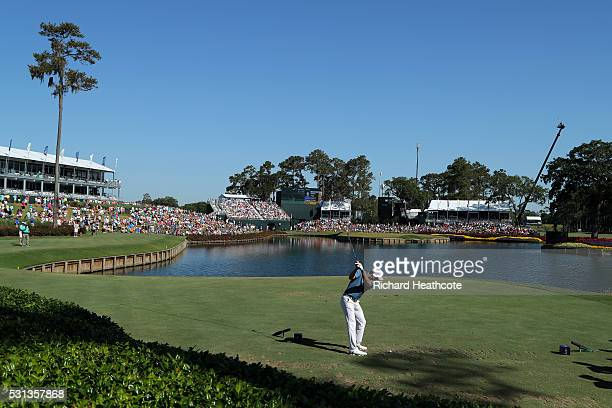 Jordan Spieth of the USA tee's off at the 17th during the resumption of the weather delayed second round of THE PLAYERS Championship at the Stadium...