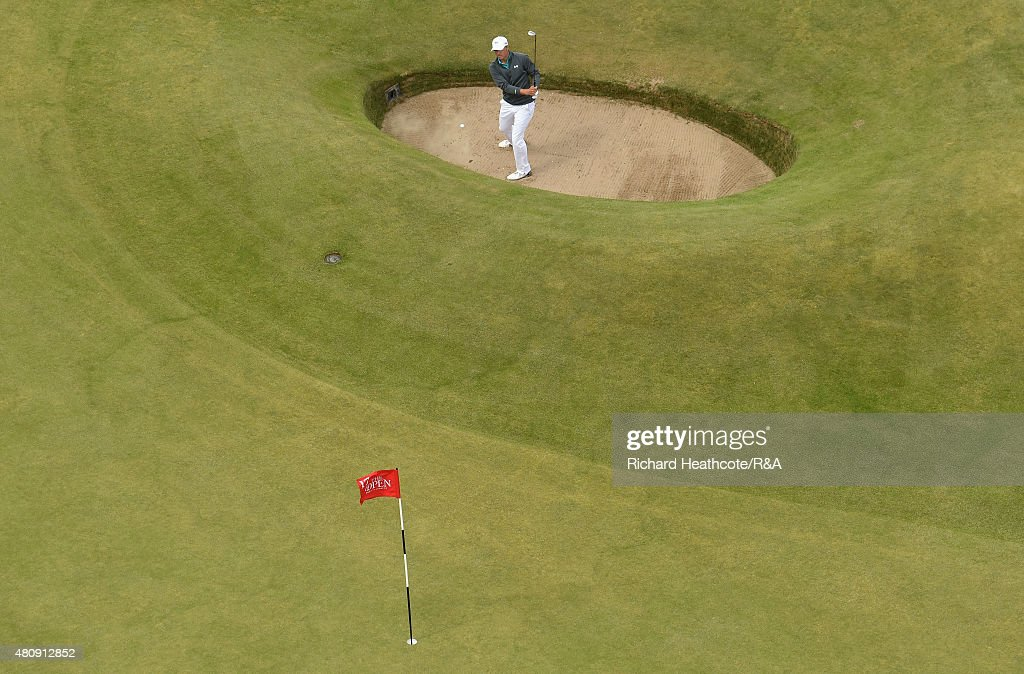 Jordan Spieth of USA hits a shot from the Road Hole bunker on the 17th hole during the first round of the 144th Open Championship at The Old Course on July 16, 2015 in St Andrews, Scotland.