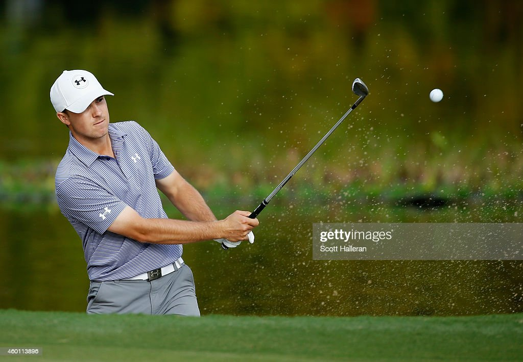 Jordan Spieth plays a bunker shot on the 11th hole during the final round of the Hero World Challenge at the Isleworth Golf & Country Club on December 7, 2014 in Windermere, Florida.
