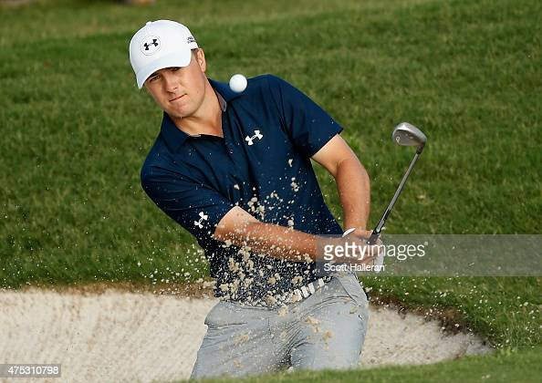 Jordan Spieth plays a bunker shot on the 15th hole during Round Three of the ATT Byron Nelson at the TPC Four Seasons Resort Las Colinas on May 30...