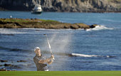 Jordan Spieth plays a bunker shot on the 18th hole during the third round of the ATT Pebble Beach National ProAm at the Pebble Beach Golf Links on...
