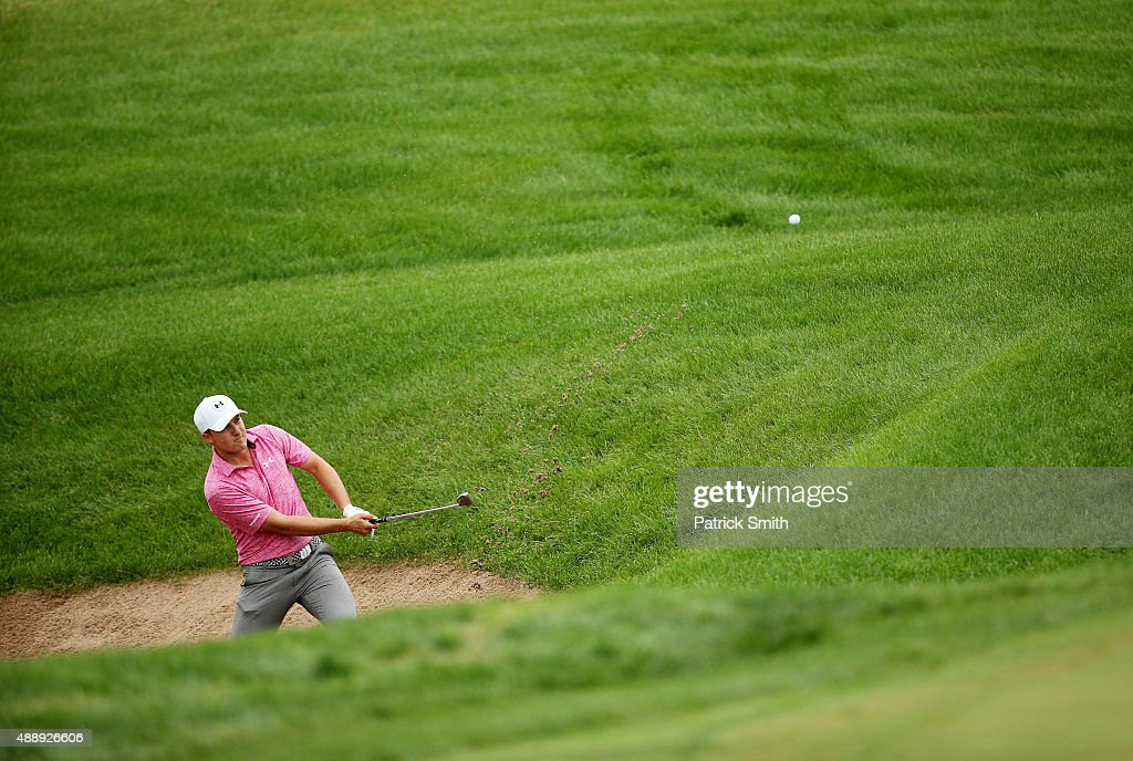 Jordan Spieth plays a shot from a bunker on the eighth hole during the Second Round of the BMW Championship at Conway Farms Golf Club on September 18, 2015 in Lake Forest, Illinois.
