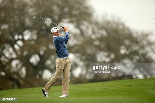 Jordan Spieth plays a shot on the 10th during Round One of the Valero Texas Open at the ATT Oaks Course on March 27 2014 in San Antonio Texas