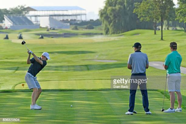 Jordan Spieth plays a shot on the second hole as United States Team Captain Steve Stricker and Charley Hoffman watch during course previews at...