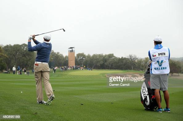 Jordan Spieth plays his second shot on the 11th during Round One of the Valero Texas Open at the ATT Oaks Course on March 27 2014 in San Antonio Texas