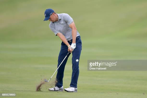 Jordan Spieth plays his second shot on the 18th hole during Round Two of the ATT Byron Nelson at the TPC Four Seasons Resort Las Colinas on May 19...