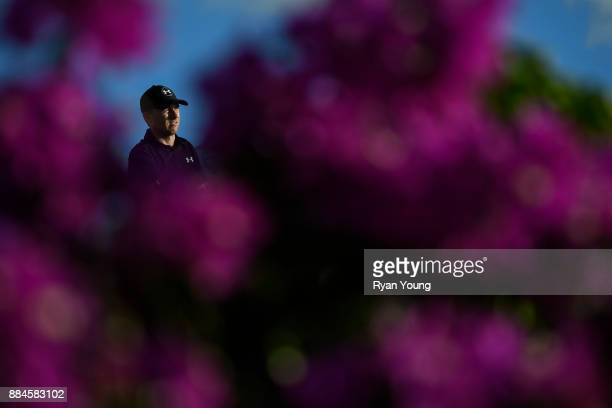 Jordan Spieth plays his shot from the 13th tee during the third round of the Hero World Challenge at Albany course on December 2 2017 in Nassau...