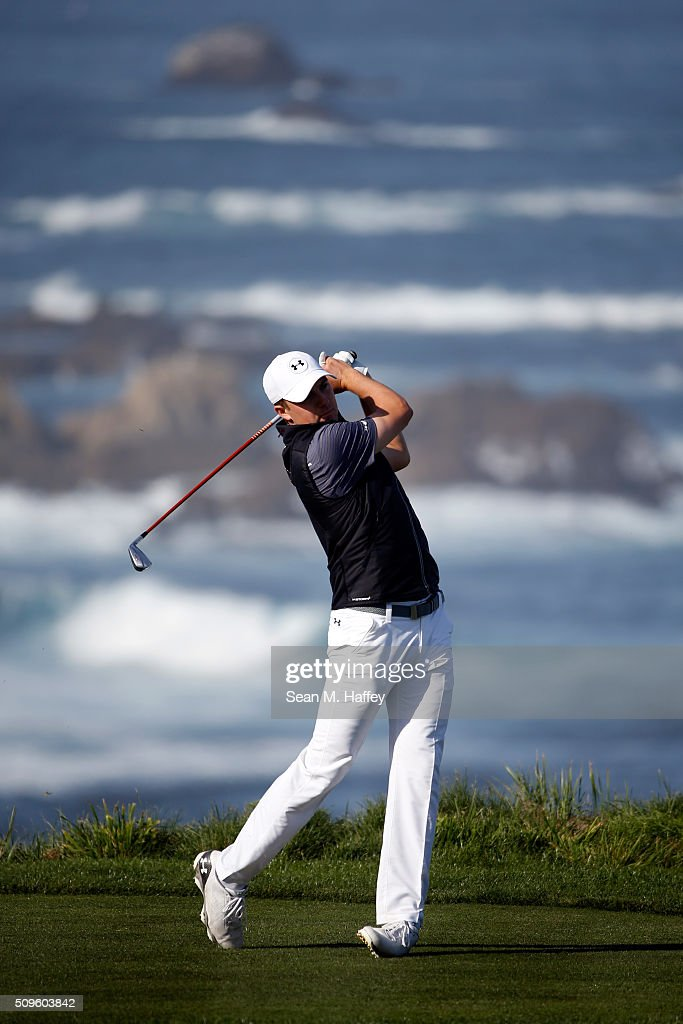 Jordan Spieth plays his tee shot on the fourth hole during the first round of the AT&T Pebble Beach National Pro-Am at the Spyglass Hill Golf Course on on February 11, 2016 in Pebble Beach, California.