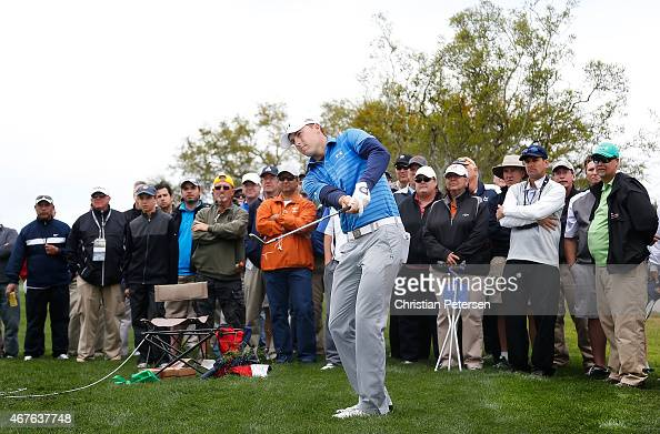 Jordan Spieth plays his third shot on the second hole as Jimmy Walker looks on during round one of the Valero Texas Open at TPC San Antonio ATT Oaks...