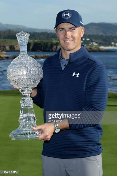 Jordan Spieth poses with the trophy after winning the ATT Pebble Beach ProAm at Pebble Beach Golf Links on February 12 2017 in Pebble Beach California