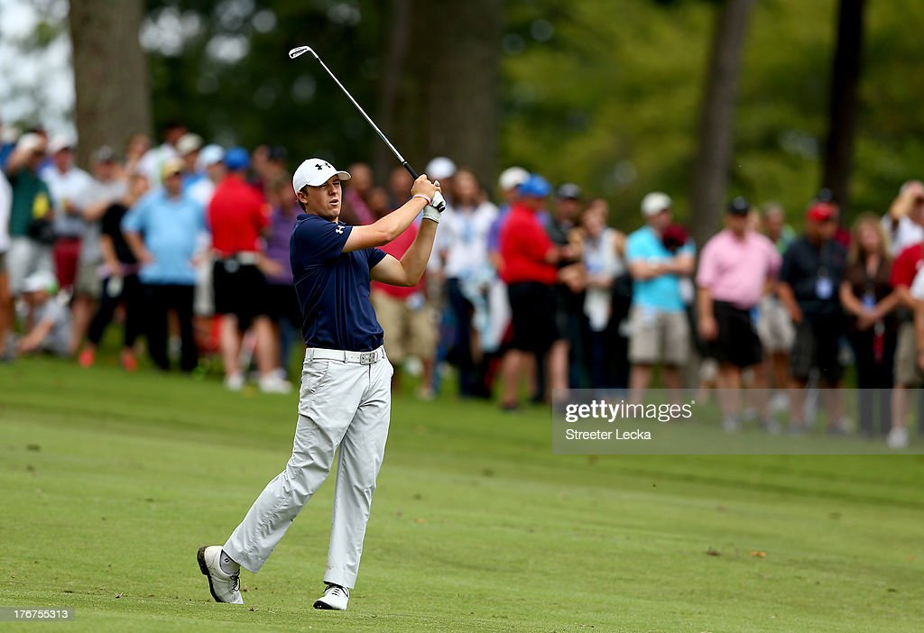 Jordan Spieth react to a shot on the 18th hole during the final round of the Wyndham Championship at Sedgefield Country Club on August 18, 2013 in Greensboro, North Carolina.