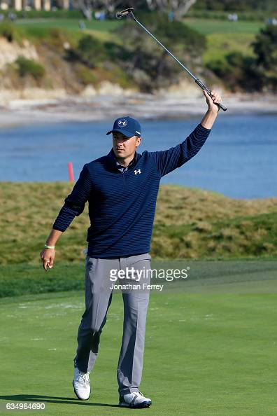 Jordan Spieth reacts after a birdie on the 17th green during the Final Round of the ATT Pebble Beach ProAm at Pebble Beach Golf Links on February 12...