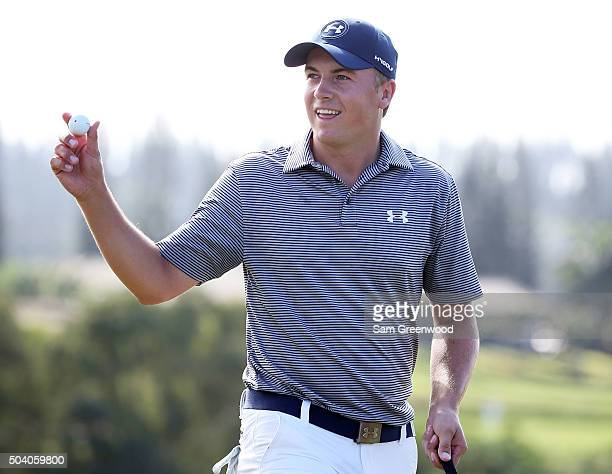 Jordan Spieth reacts after chipping for eagle on the ninth hole during round two of the Hyundai Tournament of Champions at the Plantation Course at...