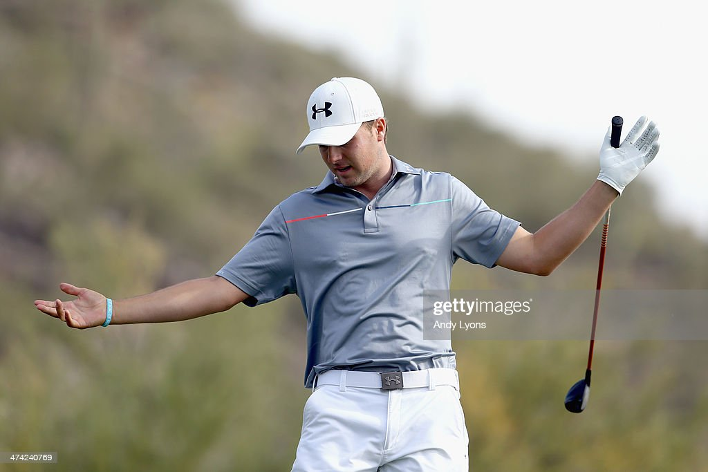 Jordan Spieth reacts after his tee shot on the 16th hole during the quarterfinal round of the World Golf Championships - Accenture Match Play Championship at The Golf Club at Dove Mountain on February 22, 2014 in Marana, Arizona.