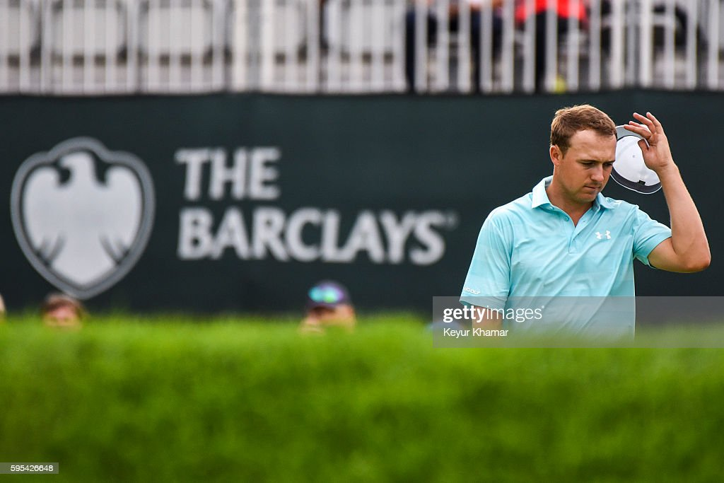 Jordan Spieth reacts after making a bogey on the 18th hole green during the first round of The Barclays at Bethpage State Park on August 25 2016 in...