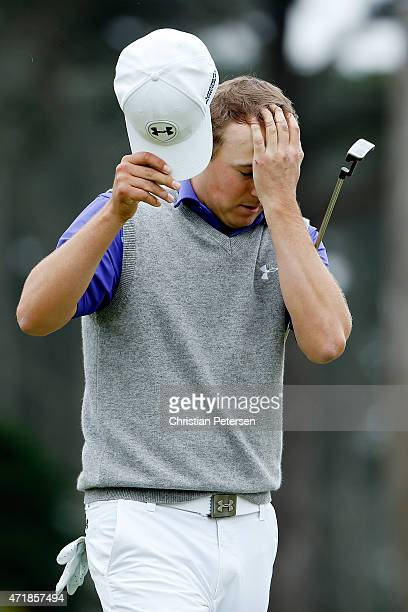 Jordan Spieth reacts after missing his putt on the 18th hole green to lose his round three match to Lee Westwood of England eliminating him from the...