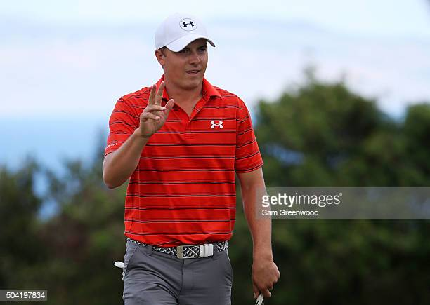 Jordan Spieth reacts after putting for birdie on the third green during the third round of the Hyundai Tournament of Champions at the Plantation...
