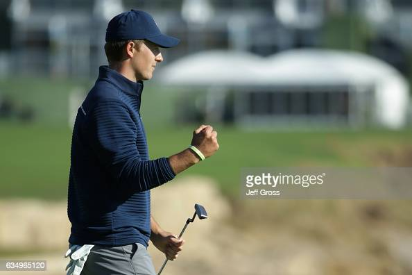 Jordan Spieth reacts after putting out on the 18th green to win the ATT Pebble Beach ProAm at Pebble Beach Golf Links on February 12 2017 in Pebble...