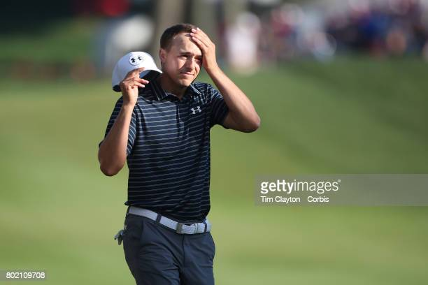 Jordan Spieth reacts as holes from the sand trap on the eighteenth during first play off hole play off during the fourth round of the Travelers...