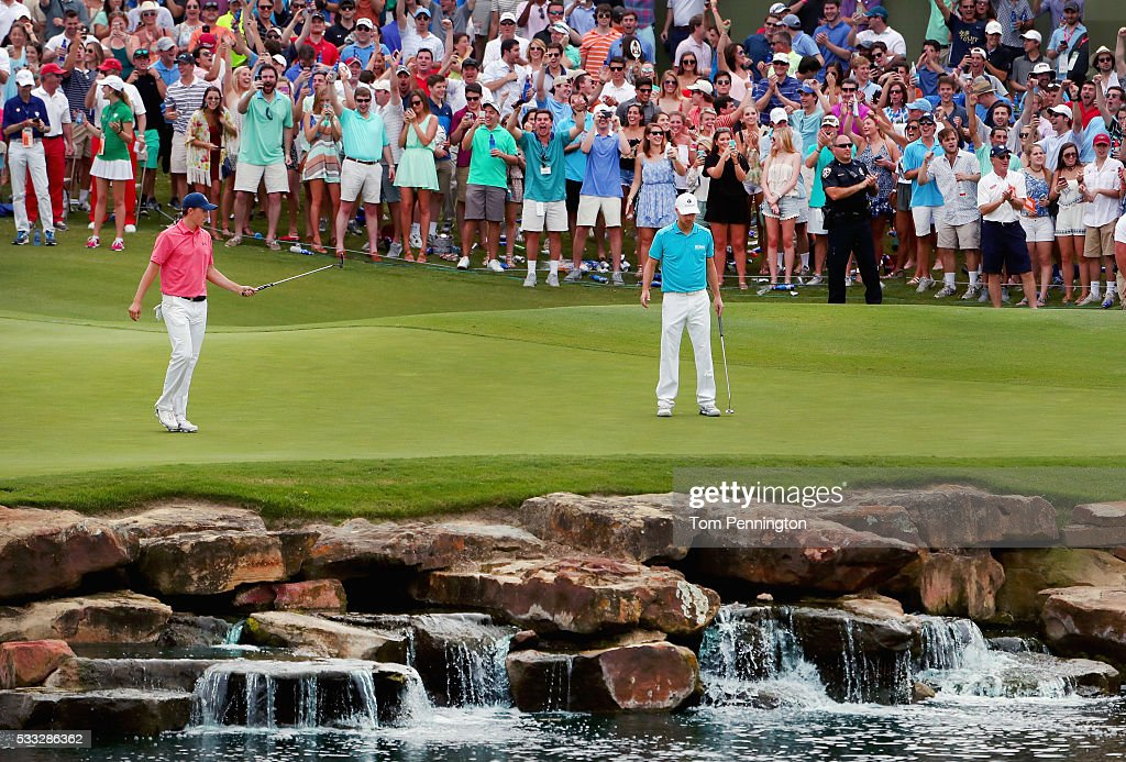 Jordan Spieth reacts to a birdie putt on the 17th hole as Brooks Koepka looks on during Round Three at the ATT Byron Nelson on May 21 2016 in Irving...