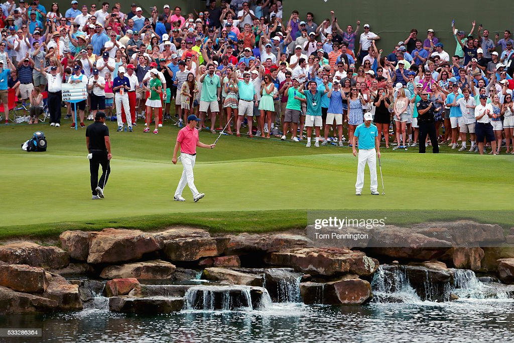 Jordan Spieth reacts to a birdie putt on the 17th hole as Brooks Koepka looks on during Round Three at the AT&T Byron Nelson on May 21, 2016 in Irving, Texas.