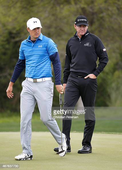 Jordan Spieth reacts to a missed putt on the third hole as Jimmy Walker looks on during round one of the Valero Texas Open at TPC San Antonio ATT...
