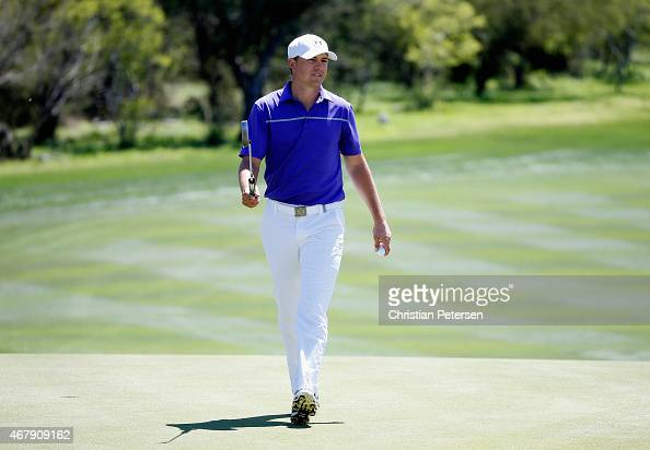 Jordan Spieth reacts to his par putt on the eighth hole during round three of the Valero Texas Open at TPC San Antonio ATT Oaks Course on March 28...