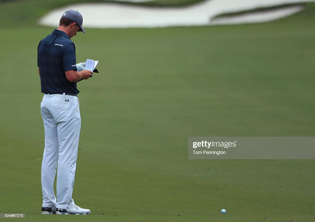 <a gi-track='captionPersonalityLinkClicked' href=/galleries/search?phrase=Jordan+Spieth&family=editorial&specificpeople=5440480 ng-click='$event.stopPropagation()'>Jordan Spieth</a> reads the yardage book on the first hole during the Third Round of the DEAN & DELUCA Invitational at Colonial Country Club on May 28, 2016 in Fort Worth, Texas.