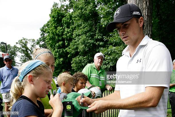 Jordan Spieth signs autographs for fans after the the third round of the John Deere Classic Round Three held at TPC Deere Run on July 12 2014 in...