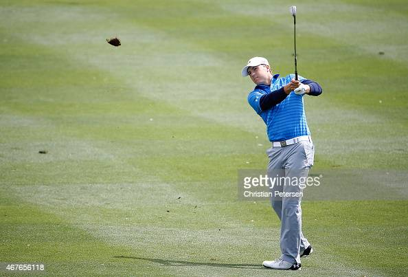 Jordan Spieth takes his second shot on the eighth hole during round one of the Valero Texas Open at TPC San Antonio ATT Oaks Course on March 26 2015...