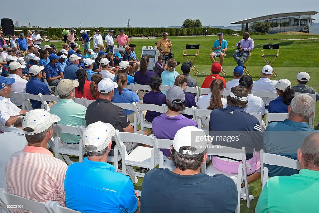 Jordan Spieth talks with Damon Hack of The Golf Channel during a First Tee clinic at Liberty National Golf Course on August 24 2015 in Jersey City...