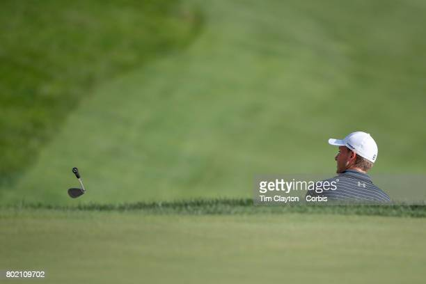 Jordan Spieth throws his club after holing from the sand trap on the eighteenth during first play off hole play off during the fourth round of the...