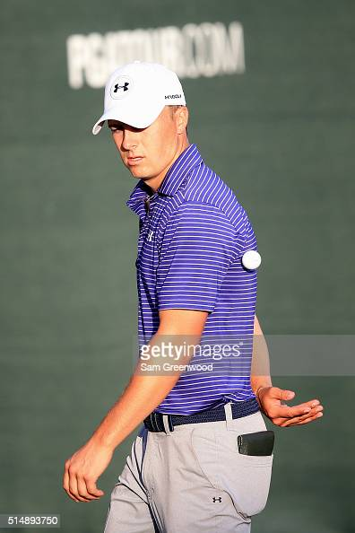 Jordan Spieth tosses a ball at the end of his round on the 18th green during the second round of the Valspar Championship at Innisbrook Resort...