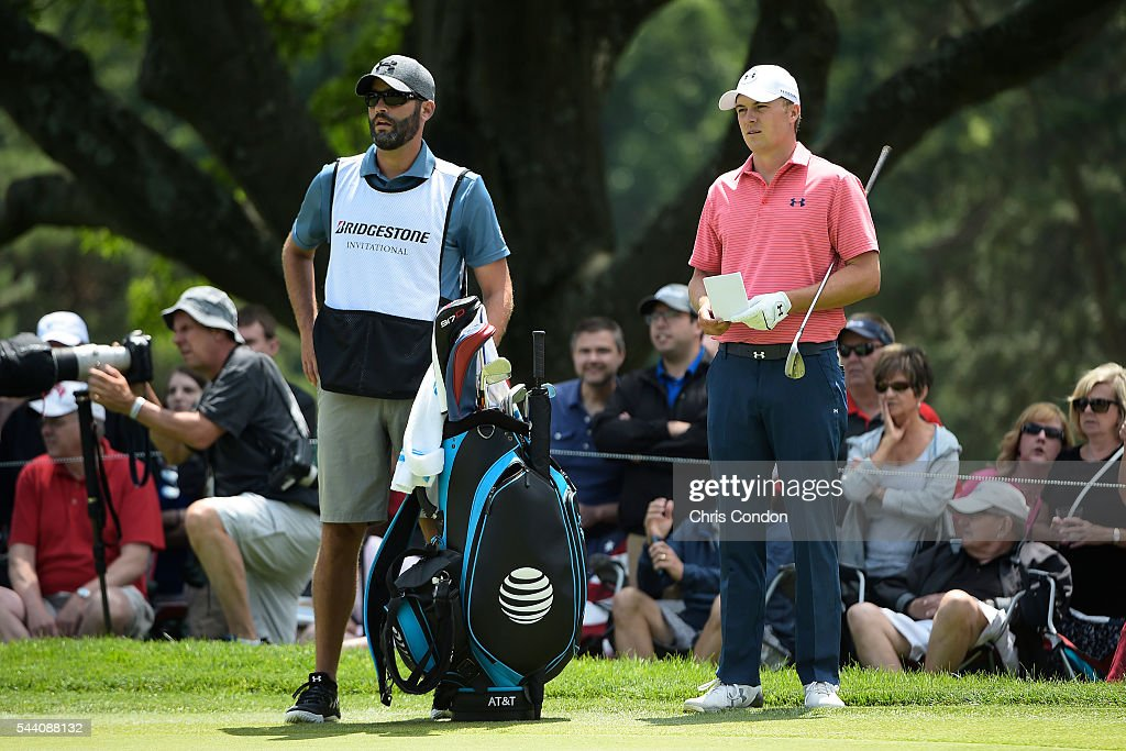 Jordan Spieth waits on the second green with caddie Michael Greller during the second round of the World Golf Championships-Bridgestone Invitational at Firestone Country Club on July 1, 2016 in Akron, Ohio.