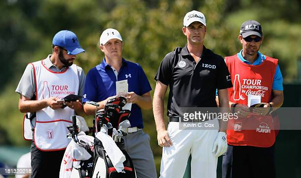 Jordan Spieth waits with Webb Simpson and their caddies on the second tee during the second round of the TOUR Championship by CocaCola at East Lake...