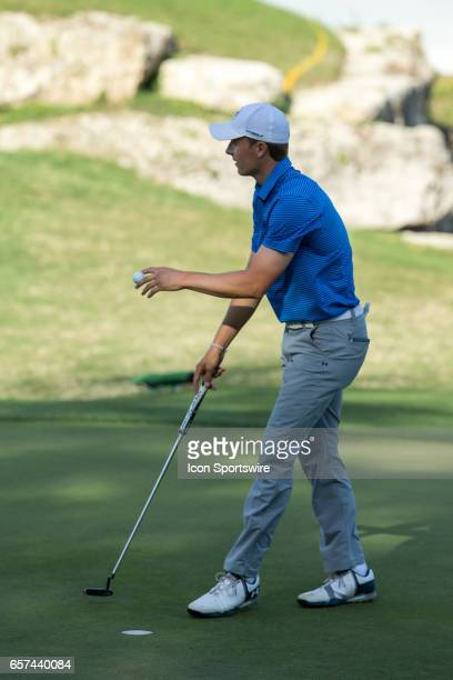 Jordan Spieth waives to the cheerig crowd after sinking his birdie putt during the second round of the WGCDell Technologies Match Play on March 23 at...