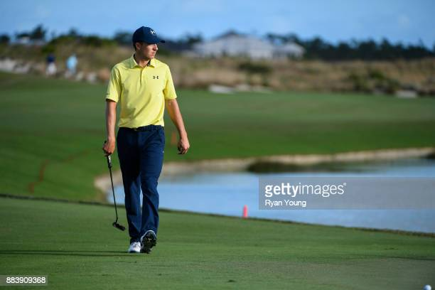 Jordan Spieth walks up the 18th fairway during the second round of the Hero World Challenge at Albany course on December 1 2017 in Nassau Bahamas