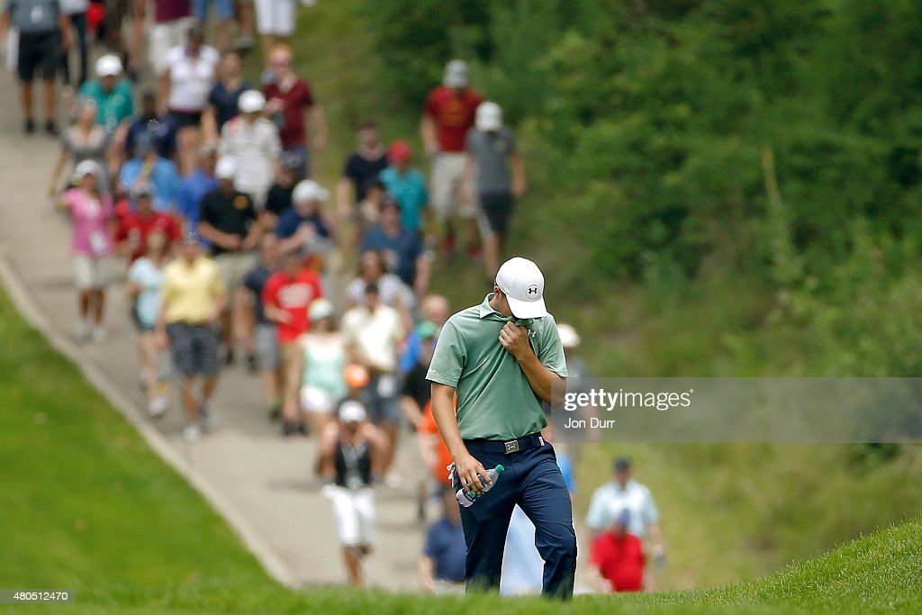 Jordan Spieth walks up the first fairway to his ball on the outside of the cart path during the final round of the John Deere Classic held at TPC Deere Run on July 12, 2015 in Silvis, Illinois.