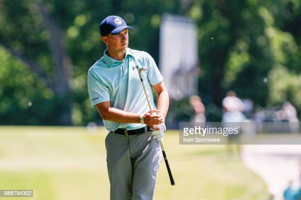 Jordan Spieth watches his chip onto the 8th green during the second round of the Dean Deluca Invitational on May 26 2017 at Colonial Country Club in...