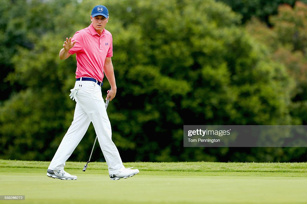 Jordan Spieth waves to the gallery after making a birdie putt on the ninth hole during Round Three at the ATT Byron Nelson on May 21 2016 in Irving...