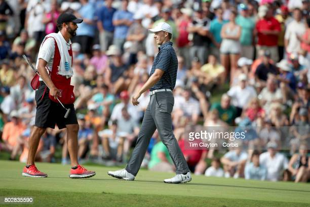 Jordan Spieth with caddie Michael Greller during the fourth round of the Travelers Championship Tournament at the TPC River Highlands Golf Course on...