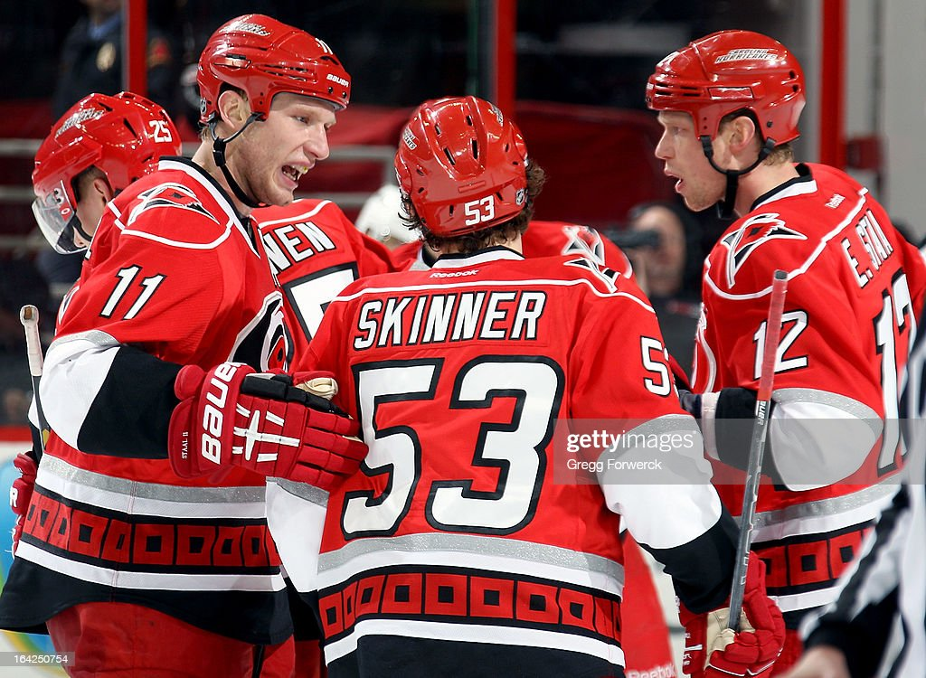 Jordan Staal #11 and Eric Staal #12 of the Carolina Hurricanes celebrate a goal scored by Jeff Skinner #53 against the New Jersey Devils during their NHL game at PNC Arena on March 21, 2013 in Raleigh, North Carolina.
