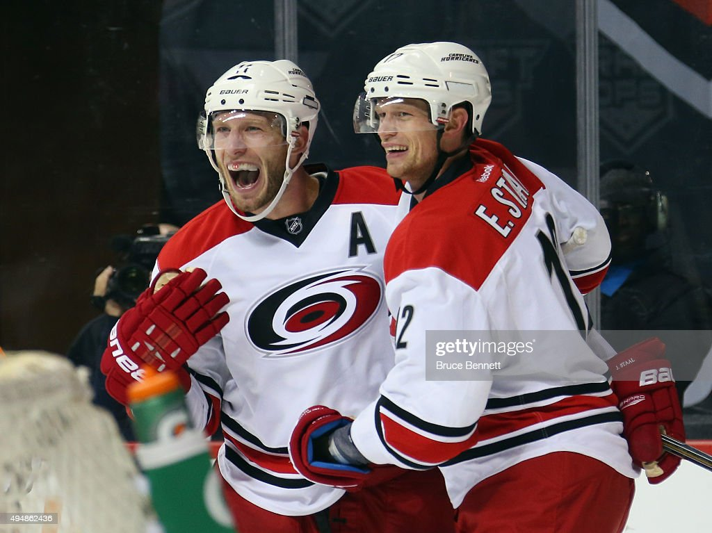 Jordan Staal #11 and Eric Staal #12 of the Carolina Hurricanes celebrate the game tying goal by Chris Terry #25 at 14:56 of the third period against the New York Islanders at the Barclays Center on October 29, 2015 in the Brooklyn borough of New York City.