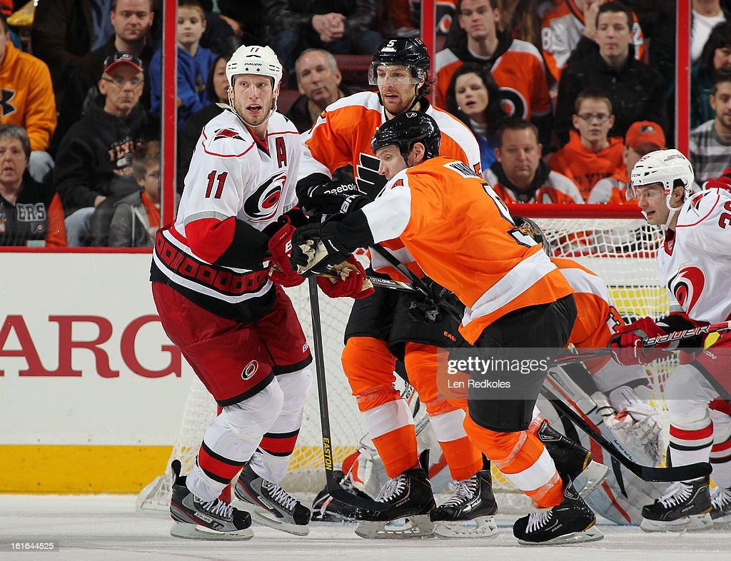 <a gi-track='captionPersonalityLinkClicked' href=/galleries/search?phrase=Jordan+Staal&family=editorial&specificpeople=533044 ng-click='$event.stopPropagation()'>Jordan Staal</a> #11 and Patrick Dwyer #39 of the Carolina Hurricanes battle against <a gi-track='captionPersonalityLinkClicked' href=/galleries/search?phrase=Mike+Knuble&family=editorial&specificpeople=202077 ng-click='$event.stopPropagation()'>Mike Knuble</a> #9 and <a gi-track='captionPersonalityLinkClicked' href=/galleries/search?phrase=Braydon+Coburn&family=editorial&specificpeople=2077063 ng-click='$event.stopPropagation()'>Braydon Coburn</a> #5 of the Philadelphia Flyers on February 9, 2013 at the Wells Fargo Center in Philadelphia, Pennsylvania.